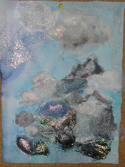 quilt top with clouds - sorry- cotton wool and wadding pinned on ...