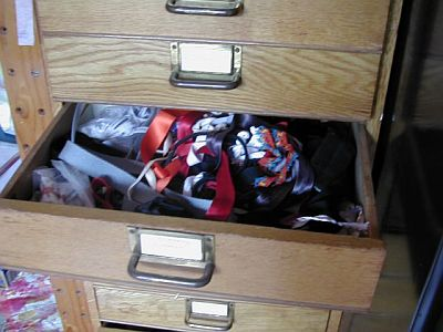 tangle of colourful ribbons in an open drawer