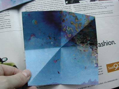 blue painted paper folded lengthwise and diagonally
