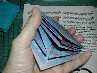 Adding another folded paper
