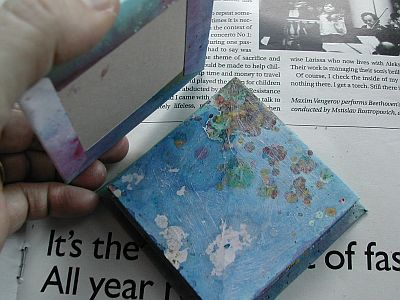 book with glue on last page ready for cover to be added