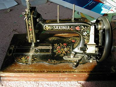 Lovely old sewing machine with decorative decals