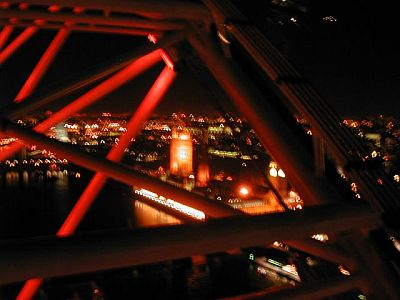 lots of blurry red beams and streetlights over London