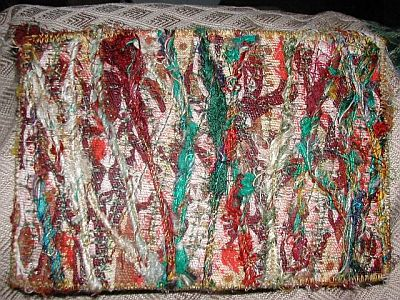 postcard with lots of lovely thick yarns couched over it vertically