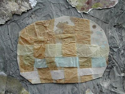 brown, blue tissue paper woven and cut to rock shape