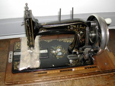 old sewing machine, heavily decorated
