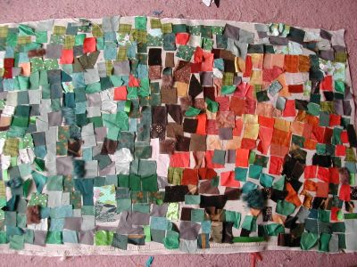 fabric mosaic in green, orange and more orange (and brown)