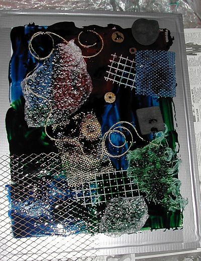 screen with lots of dye on it and all sorts of strange things pressed into it