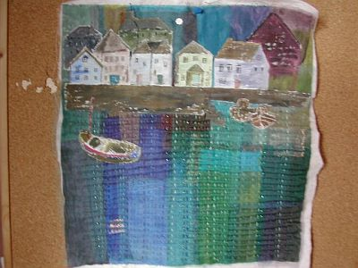layered fabrics and painted houses stitched with running stitch