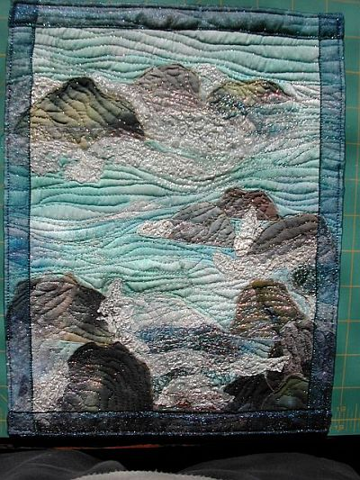 sea quilt with rocks
