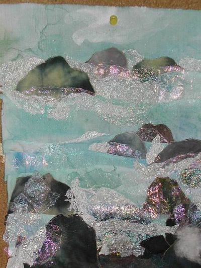 rocks, spray and shiny stuff stitched to blue water fabric