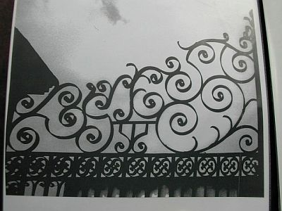 picture of very decorative triangular top of wrought iron gate