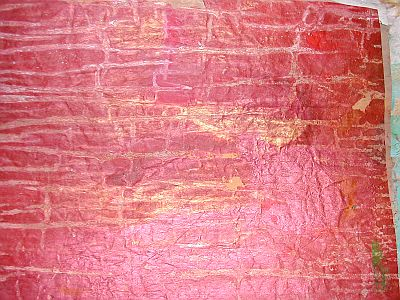 red paper with brick-like texture