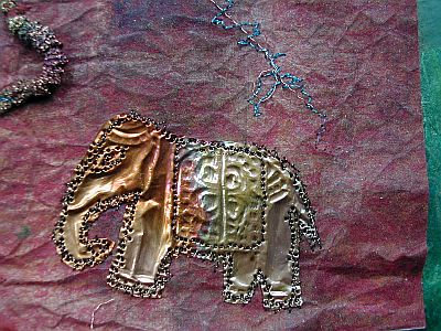 metal elephant sewed on to background