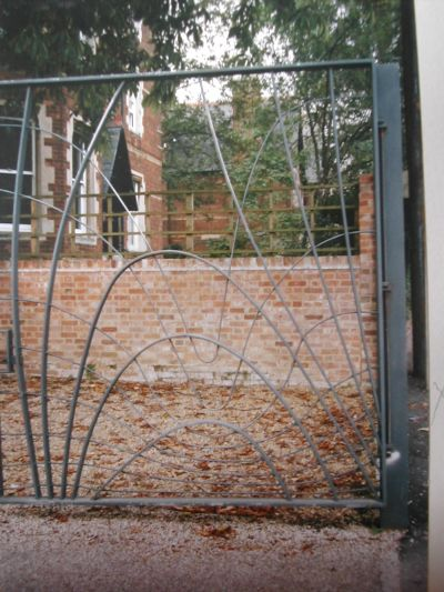 wrought iron gate with flowing lines