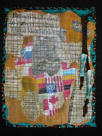 orange journal quilt with map of africa and torn newspaper about situation there