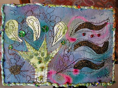 stitched collage postcard with beads and thick threads
