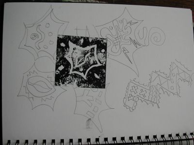 sketchbook with doodles and print