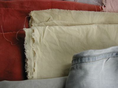 pale yellow fabric on top of the red madder dyed fabric