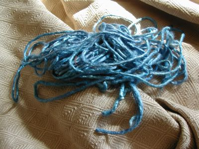 scraps of blue silk yarn
