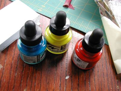 red, yellow and blue bottles of inks